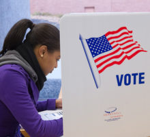 Photo: student at a voting booth