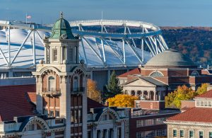 Aerial view of the Syracuse University campus zoomed in the roof of the stadium.